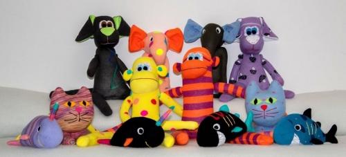 Različne igrače iz blaga - kuža, muca, riba, slon