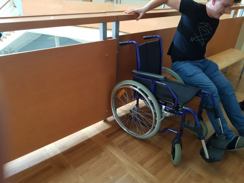Presedanje na invalidski voziček